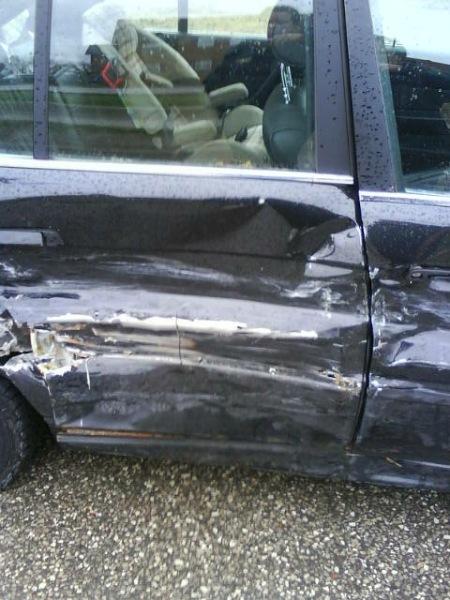 Passenger side damage. Thanks a million, Ashley